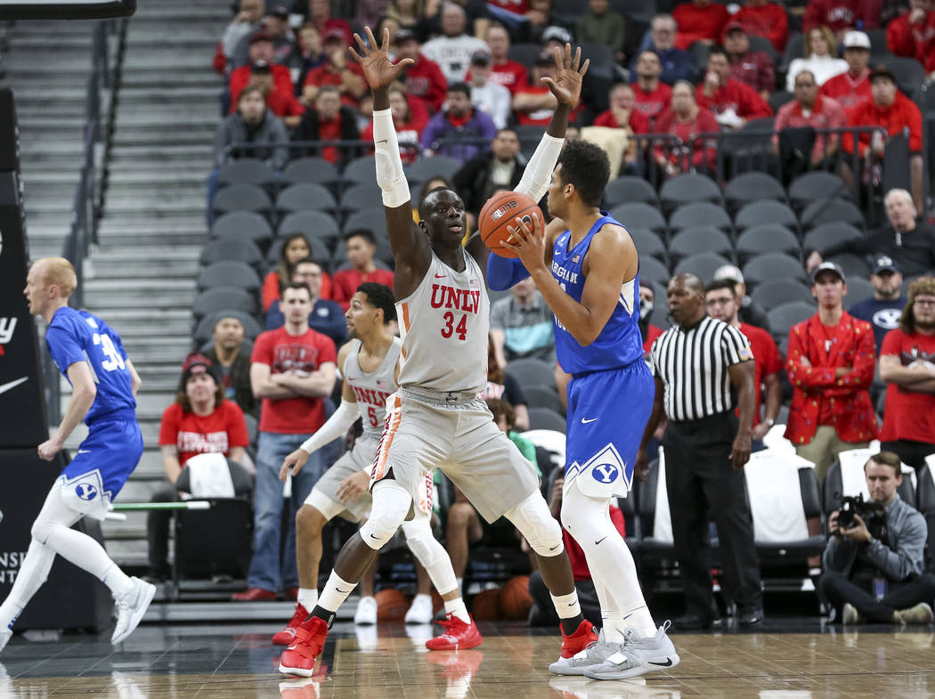 UNLV Rebels forward Cheikh Mbacke Diong (34) defends against Brigham Young Cougars forward Yoeli Childs (23) during the first half of an NCAA college basketball game at T-Mobile Arena in Las Vegas ...