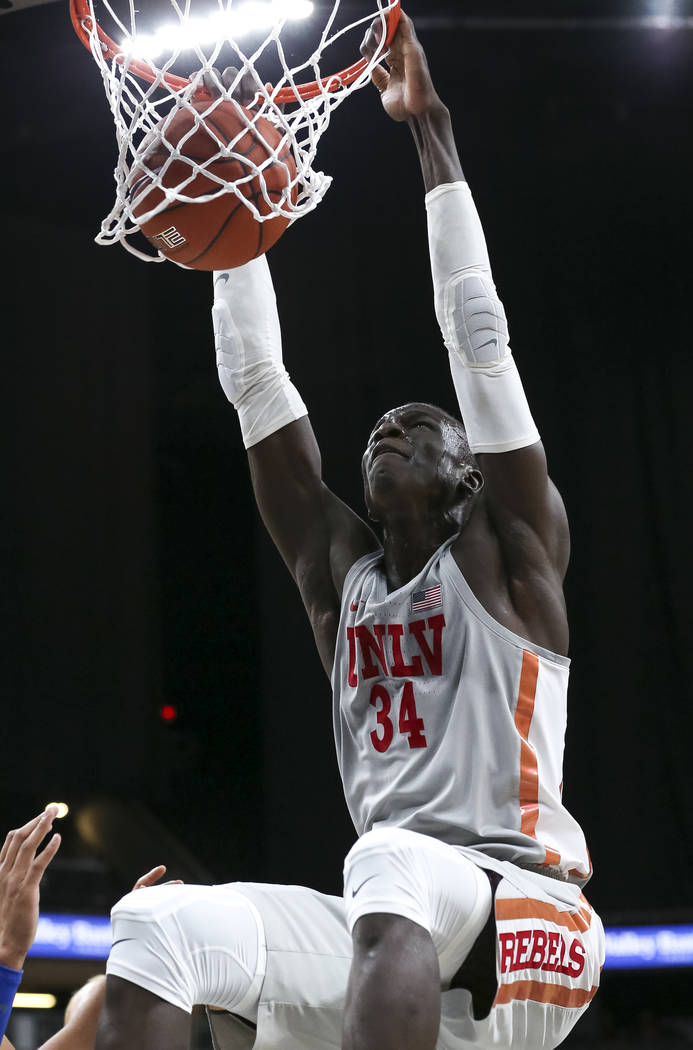 UNLV Rebels forward Cheikh Mbacke Diong (34) dunks against the Brigham Young Cougars during the first half of an NCAA college basketball game at T-Mobile Arena in Las Vegas on Saturday, Dec. 15, ...