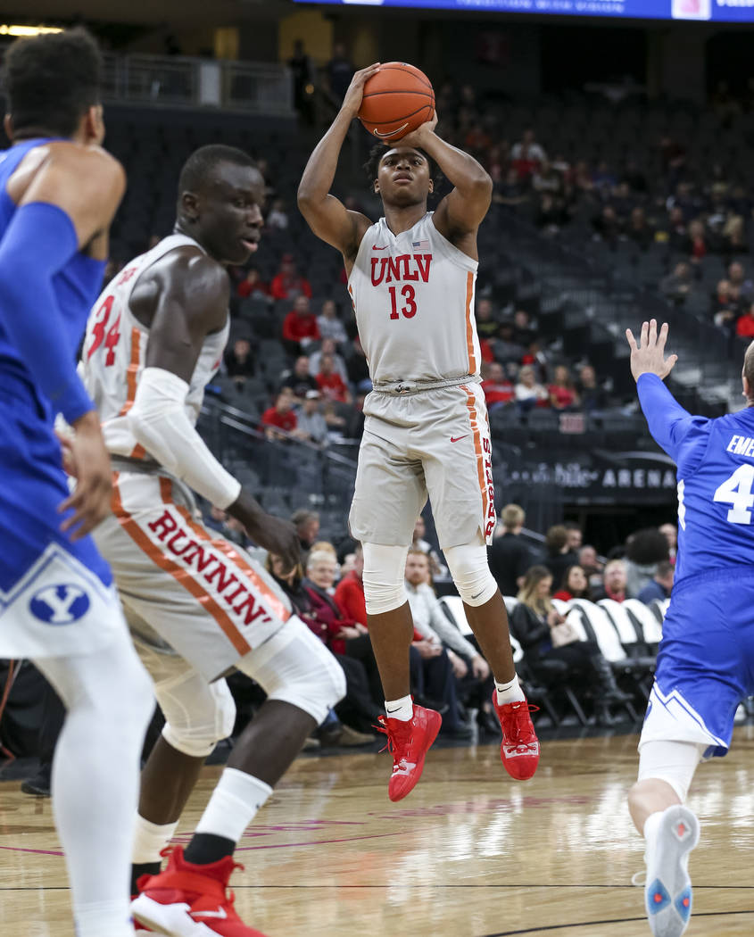 UNLV Rebels guard Bryce Hamilton (13) shoots for three against the Brigham Young Cougars during the first half of an NCAA college basketball game at T-Mobile Arena in Las Vegas on Saturday, Dec. 1 ...