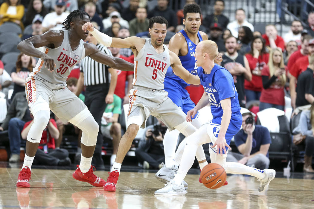 UNLV Rebels guard Noah Robotham (5) defends against Brigham Young Cougars guard TJ Haws (30) during the first half of an NCAA college basketball game at T-Mobile Arena in Las Vegas on Saturday, De ...