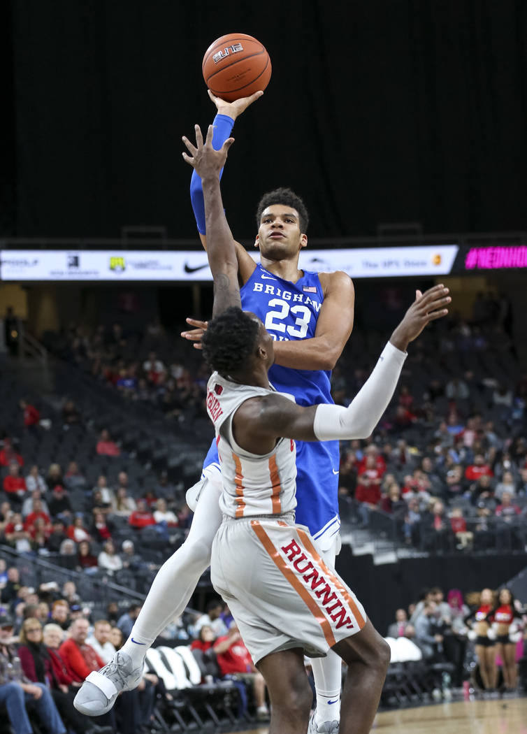 Brigham Young Cougars forward Yoeli Childs (23) shoots over UNLV Rebels guard Kris Clyburn (1) during the second half of an NCAA college basketball game at T-Mobile Arena in Las Vegas on Saturday ...