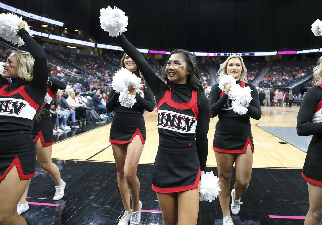 UNLV Rebels cheerleaders hype the crowd on a timeout against the Brigham Young Cougars during the second half of an NCAA college basketball game at T-Mobile Arena in Las Vegas on Saturday, Dec. 15 ...