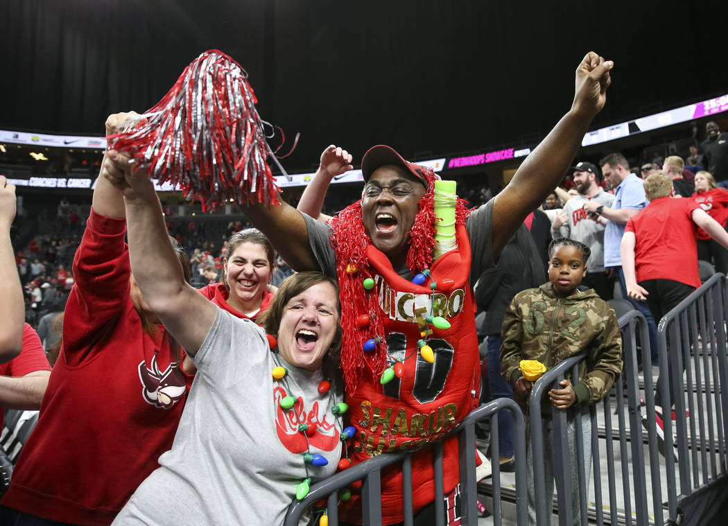 UNLV Rebels fans celebrate after the Rebels defeated the Brigham Young Cougars 92-90 following an NCAA college basketball game at T-Mobile Arena in Las Vegas on Saturday, Dec. 15, 2018. Richard Br ...