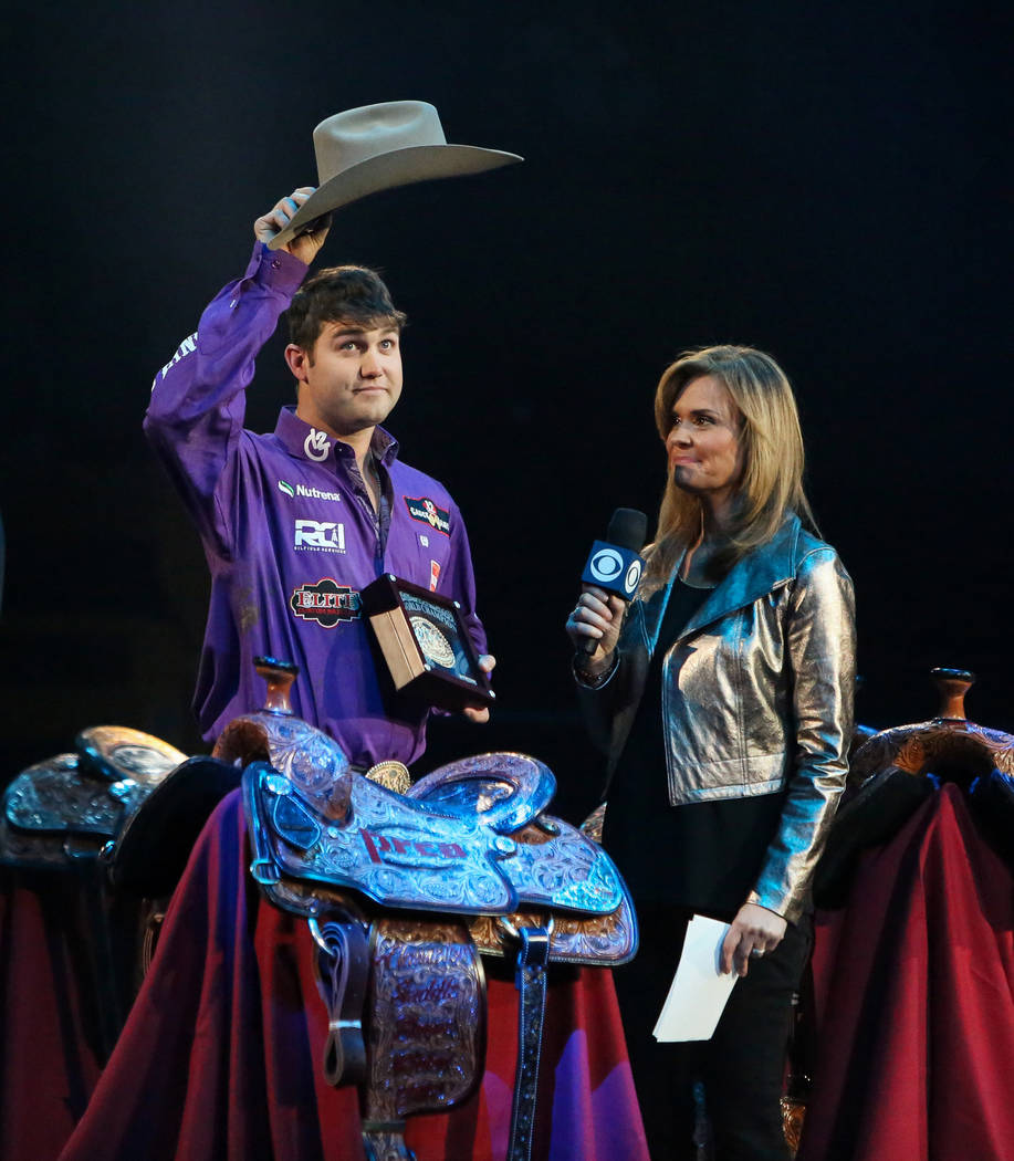 Tyler Waguespack of Gonzales, LA (88) is honored on stage after winning the Steer Wrestling category during the tenth go-round of the National Finals Rodeo at the Thomas & Mack Center in Las V ...