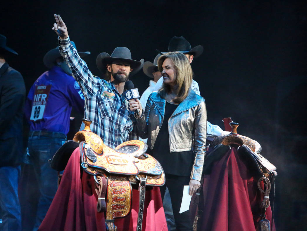 Wade Sundell of Boxholm, Iowa (47) is honored on stage after winning the Saddle Bronc Riding category during the tenth go-round of the National Finals Rodeo at the Thomas & Mack Center in Las ...