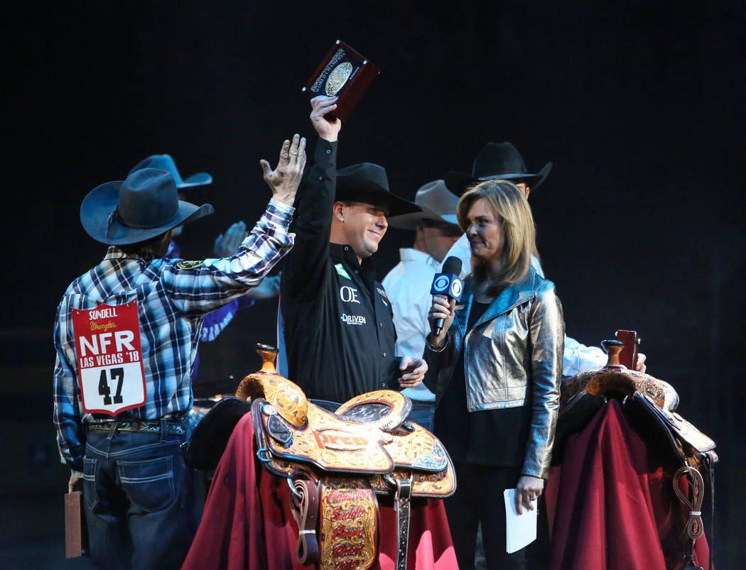 Trevor Brazile of Decatur, Texas (2) is honored on stage after becoming the 2018 PRCA All Around World Campion during the tenth go-round of the National Finals Rodeo at the Thomas & Mack Cente ...
