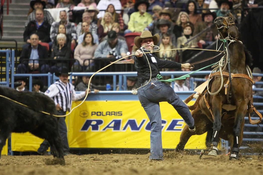Cooper Martin of Alma, Kan. (52) competes in tie-down roping during the tenth go-round of the National Finals Rodeo at the Thomas & Mack Center in Las Vegas, Saturday, Dec. 15, 2018. Caroline ...