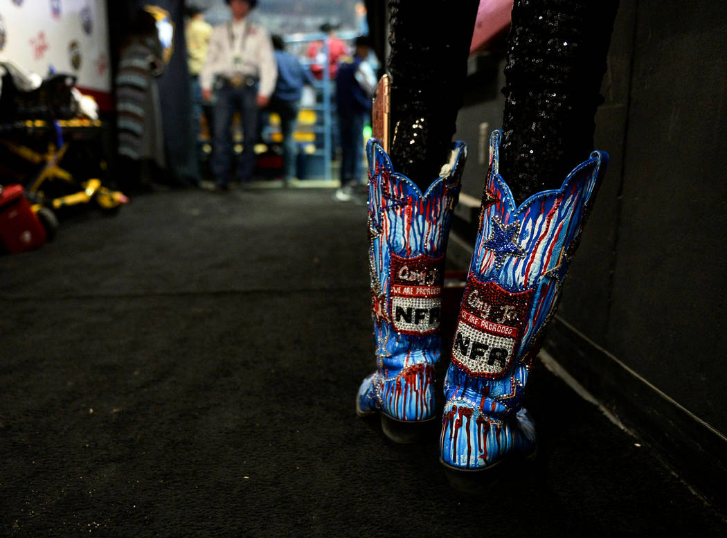 A fan wears National Finals Rodeo themed boots during the tenth go-round of the National Finals Rodeo at the Thomas & Mack Center in Las Vegas, Saturday, Dec. 15, 2018. Caroline Brehman/Las Ve ...