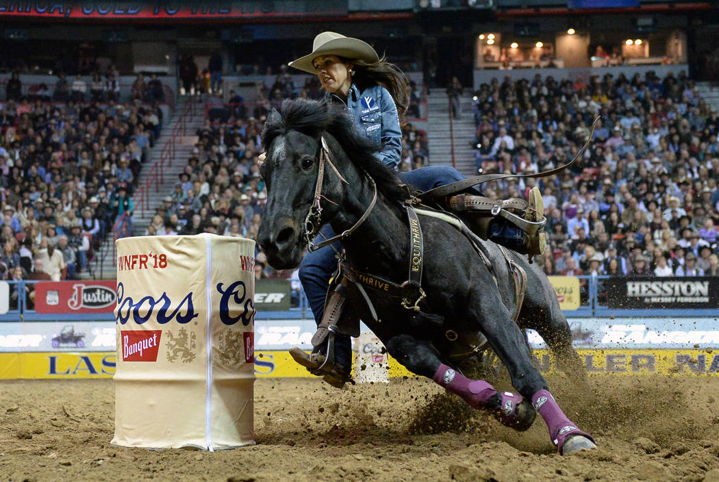 Nellie Miller of Cottonwood, Calif. (109) competes in barrel racing during the tenth go-round of the National Finals Rodeo at the Thomas & Mack Center in Las Vegas, Saturday, Dec. 15, 2018. Ca ...