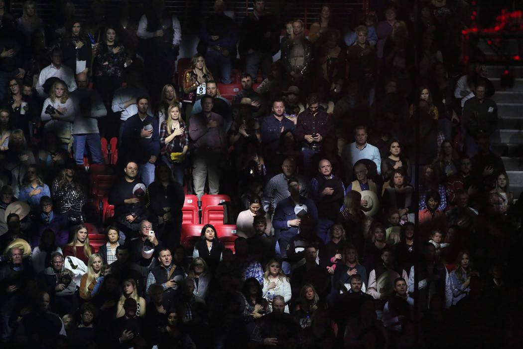 Attendees stand during the national anthem before the start of the tenth go-round of the National Finals Rodeo at the Thomas & Mack Center in Las Vegas, Saturday, Dec. 15, 2018. Caroline Brehm ...