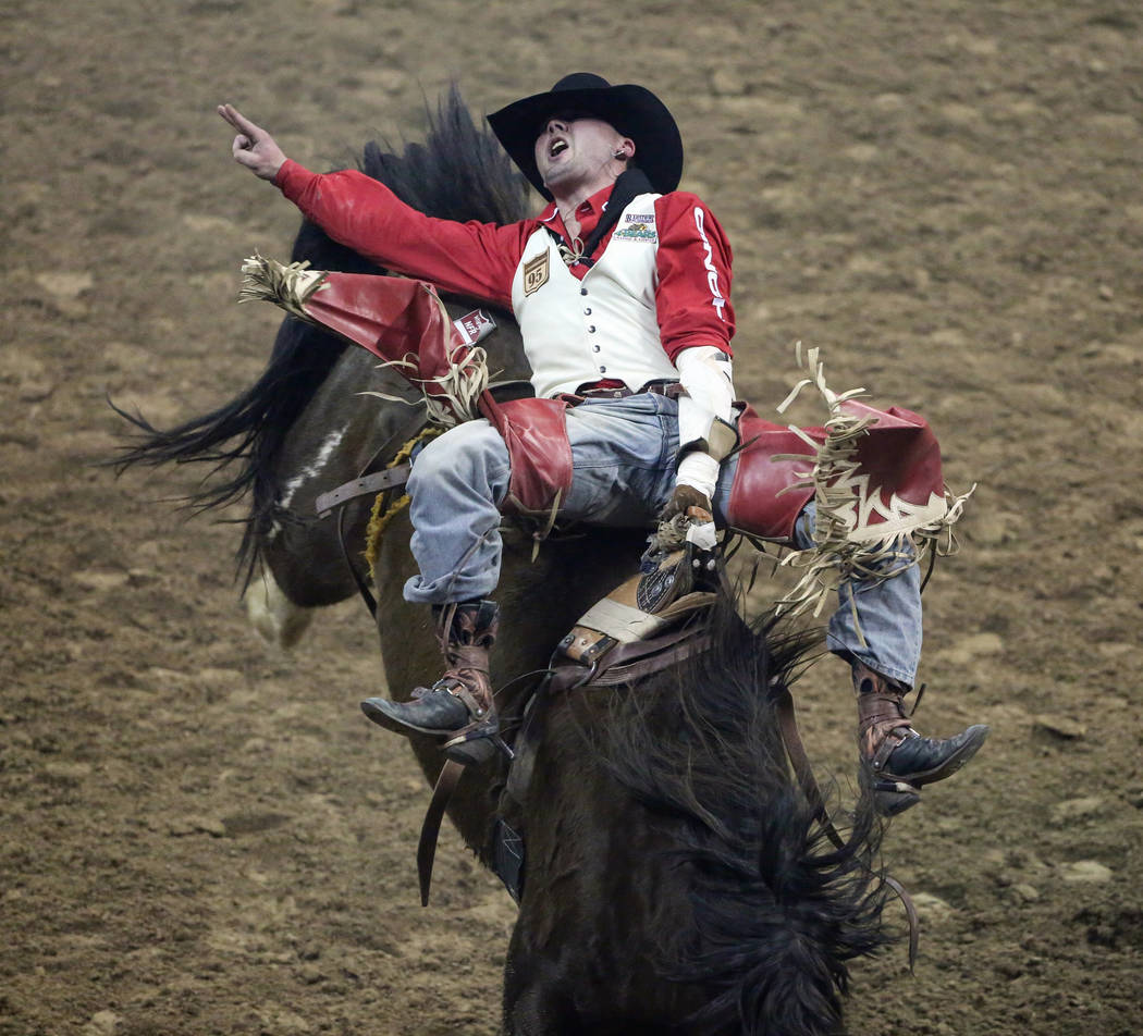 """Shane O'Connell of Rapid City, S.D. (87) rides """"Blessed Assurance"""" while competing in bareback riding during the tenth go-round of the National Finals Rodeo at the Thomas & Mack Cent ..."""