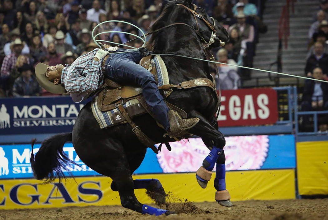 Junior Nogueira of Brazil (16) competes in team roping during the tenth go-round of the National Finals Rodeo at the Thomas & Mack Center in Las Vegas, Saturday, Dec. 15, 2018. Caroline Brehma ...
