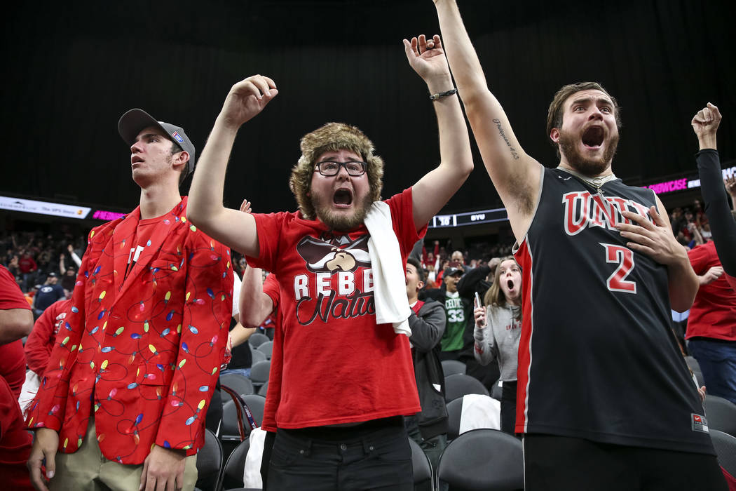 UNLV Rebels fans celebrate the game-winning shot by Rebels guard Noah Robotham (5) to defeat the Brigham Young Cougars 92-90 following an NCAA college basketball game at T-Mobile Arena in Las Vega ...