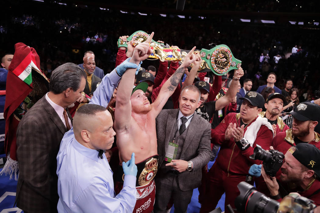 Mexico's Canelo Alvarez celebrates after a WBA super middleweight championship boxing match against England's Rocky Fielding Sunday, Dec. 16, 2018, in New York. Alvarez stopped Fielding in the thi ...