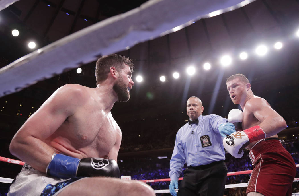 England's Rocky Fielding, left, reacts as the referee stops the fight after Mexico's Canelo Alvarez, right, knocked him down during the third round of a WBA super middleweight championship boxing ...