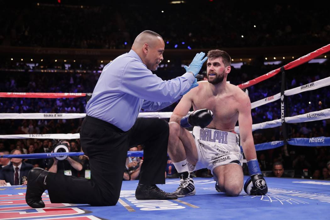 The referee counts for England's Rocky Fielding after he was knocked down during the first round of a WBA super middleweight championship boxing match against Mexico's Canelo Alvarez Saturday, Dec ...