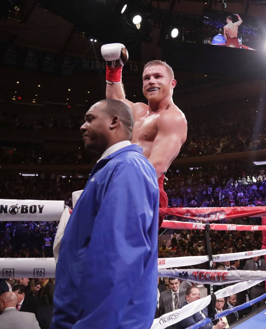 Mexico's Canelo Alvarez celebrates after a WBA super middleweight championship boxing match against England's Rocky Fielding Saturday, Dec. 15, 2018, in New York. Alvarez stopped Fielding in the t ...