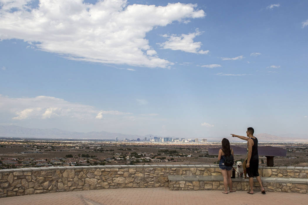 Eric and Rose Chung take in the views at Exploration Peak Park with their dogs Scooby and Furrawrri on Sunday, Aug. 6, 2017. The Las Vegas Valley can expect dry conditions and high temperatures in ...