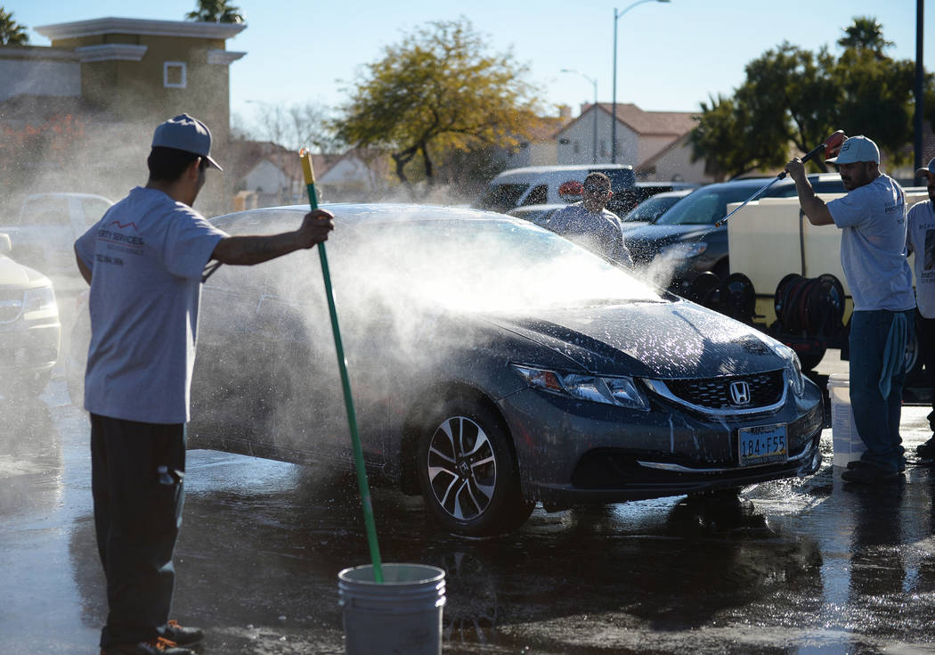 Friends of Jonathan Garcia, who died Wednesday after falling outside Trump hotel, hold a carwash fundraiser in Las Vegas, Sunday, Dec. 16, 2018. Caroline Brehman/Las Vegas Review-Journal