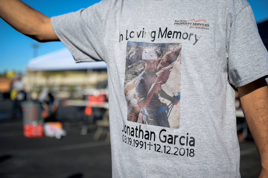 Friends of Jonathan Garcia, who died Wednesday after falling outside Trump hotel, hold a carwash fundraiser wearing t-shirts with his photograph to remember the life of their fallen friend in Las ...
