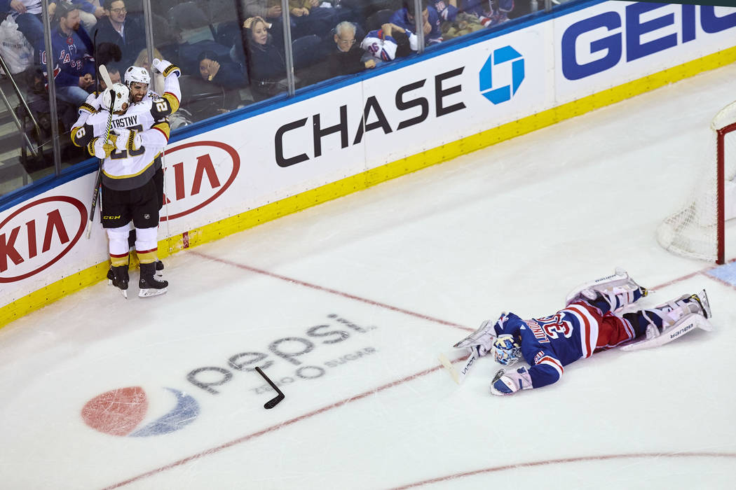 Vegas Golden Knights' Alex Tuch (89) celebrates his goal with Paul Stastny, left, during overtime of an NHL hockey game against the New York Rangers, Sunday, Dec. 16, 2018, in New York. (AP Photo/ ...
