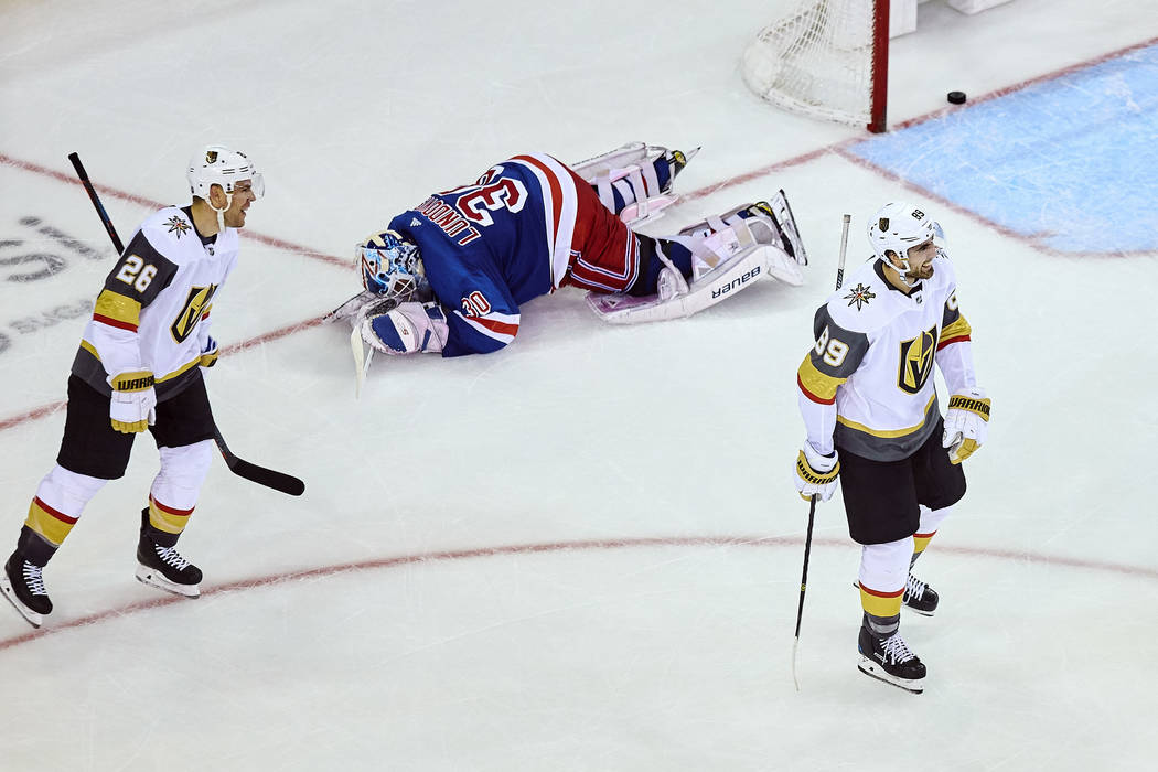 Vegas Golden Knights' Alex Tuch, (89), right, celebrates with Paul Stastny, left, after scoring his goal as New York Rangers' goalkeeper Henrik Lundqvist, center, reacts on the floor during overti ...