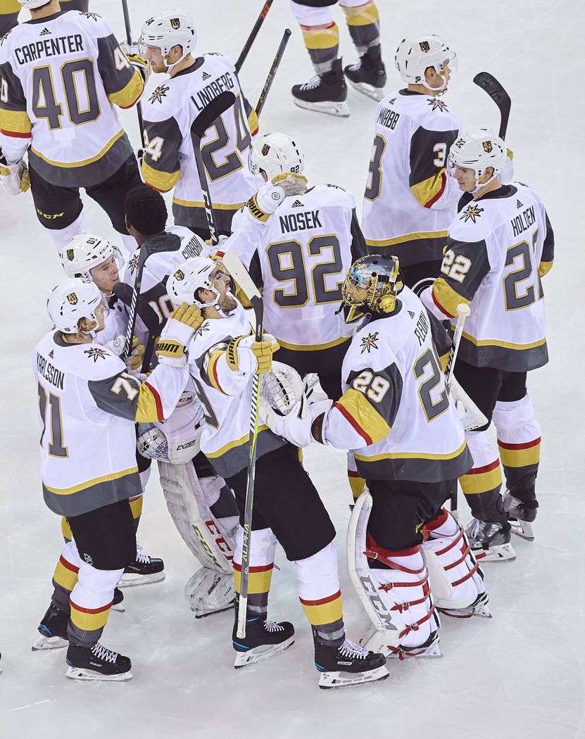 Vegas Golden Knights' Alex Tuch, bottom center, celebrates with teammates after scoring a goal during overtime of an NHL hockey game against the New York Rangers, Sunday, Dec. 16, 2018, in New Yor ...