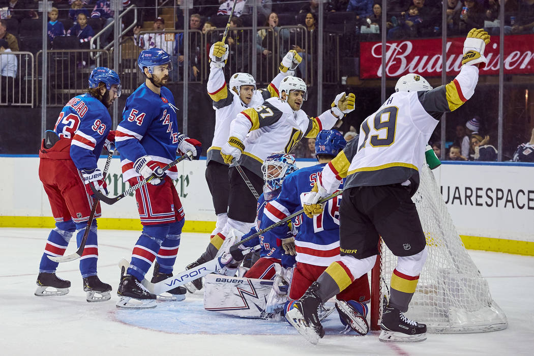 Vegas Golden Knights' Reilly Smith, right, celebrates after scoring a goal during the first period of an NHL hockey game against the New York Rangers, Sunday, Dec. 16, 2018, in New York. (AP Photo ...