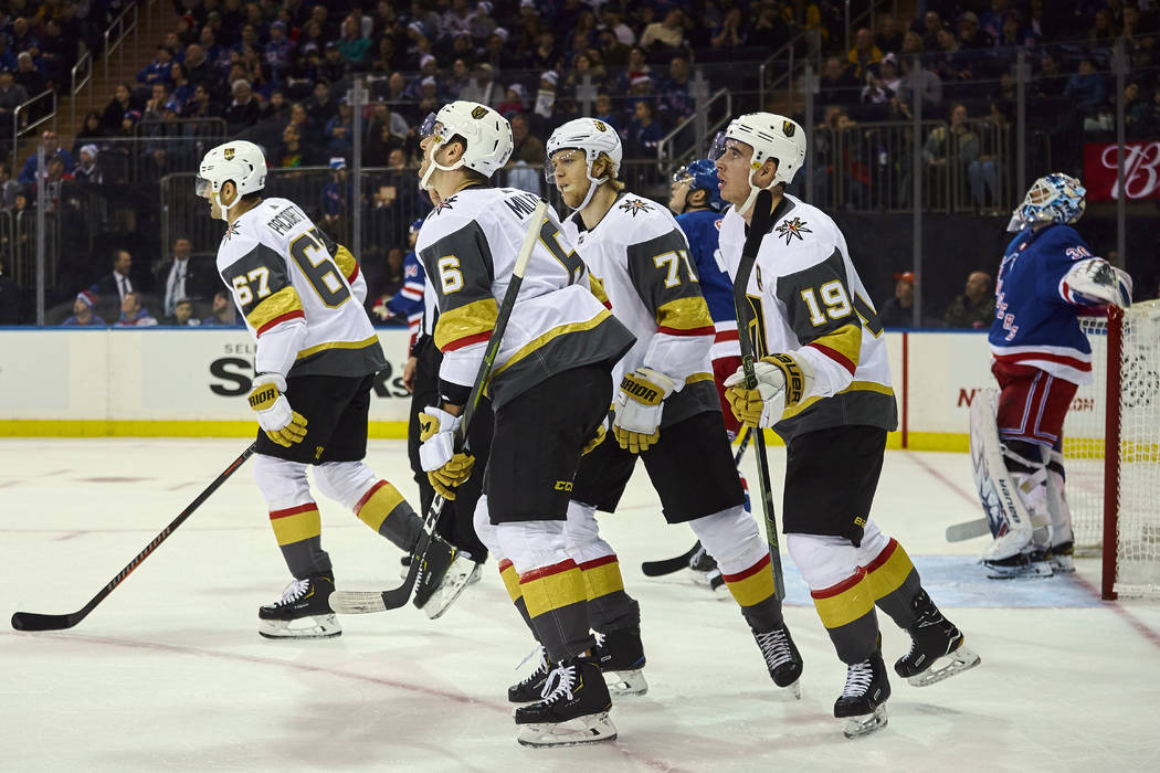 Vegas Golden Knights' Reilly Smith, (19) celebrates after scoring a goal during the first period of an NHL hockey game against New York Rangers, Sunday, Dec. 16, 2018, in New York. (AP Photo/Andre ...
