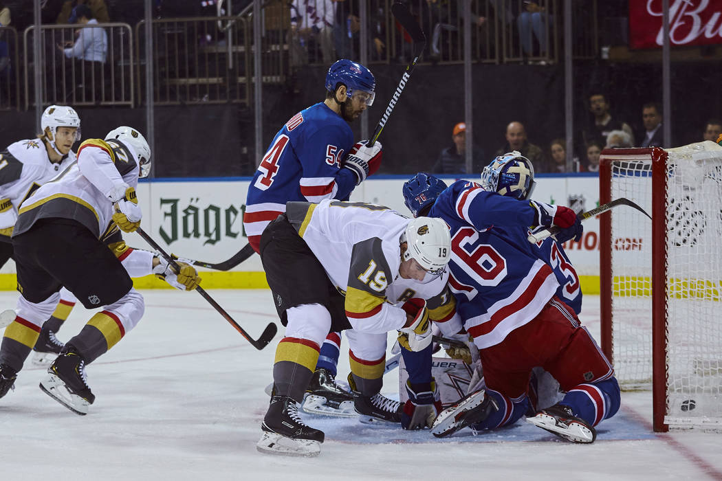 Vegas Golden Knights' Reilly Smith, (19) center, scores a goal during the first period of an NHL hockey game against New York Rangers, Sunday, Dec. 16, 2018, in New York. (AP Photo/Andres Kudacki)