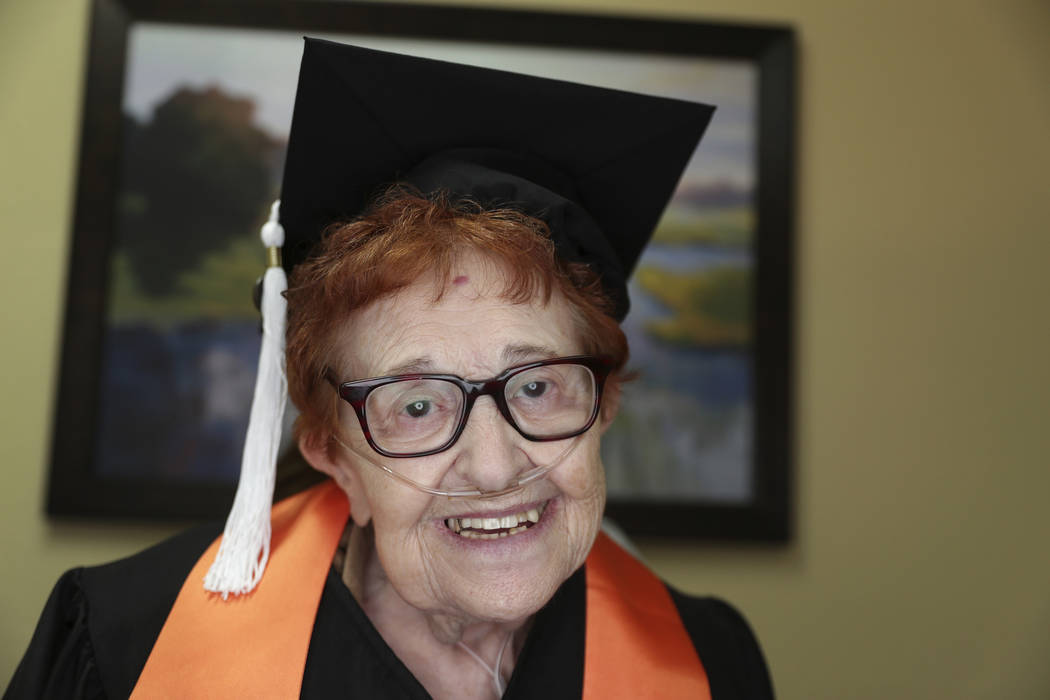 In this Dec. 10, 2018 photo, Janet Fein, 84, poses for a photo in Richardson, Texas. Fein completed her bachelor's degree and will graduate from the University of Texas at Dallas with the winter u ...