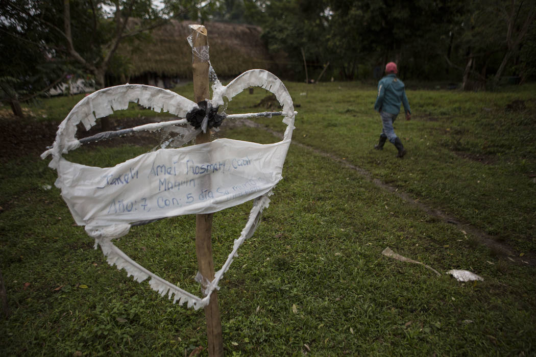 A heart-shaped sign displays the name of Jakelin Amei Rosmey Caal in Raxruha, Guatemala, on Saturday, Dec. 15, 2018. The 7-year-old girl died in a Texas hospital, two days after being taken into c ...