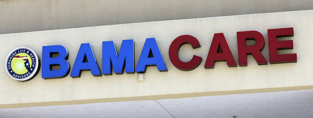 File- This May 11, 2017, file photo shows an Obamacare sign being displayed on the storefront of an insurance agency in Hialeah, Fla. A conservative federal judge in Texas on Friday, Dec. 14, 2018 ...