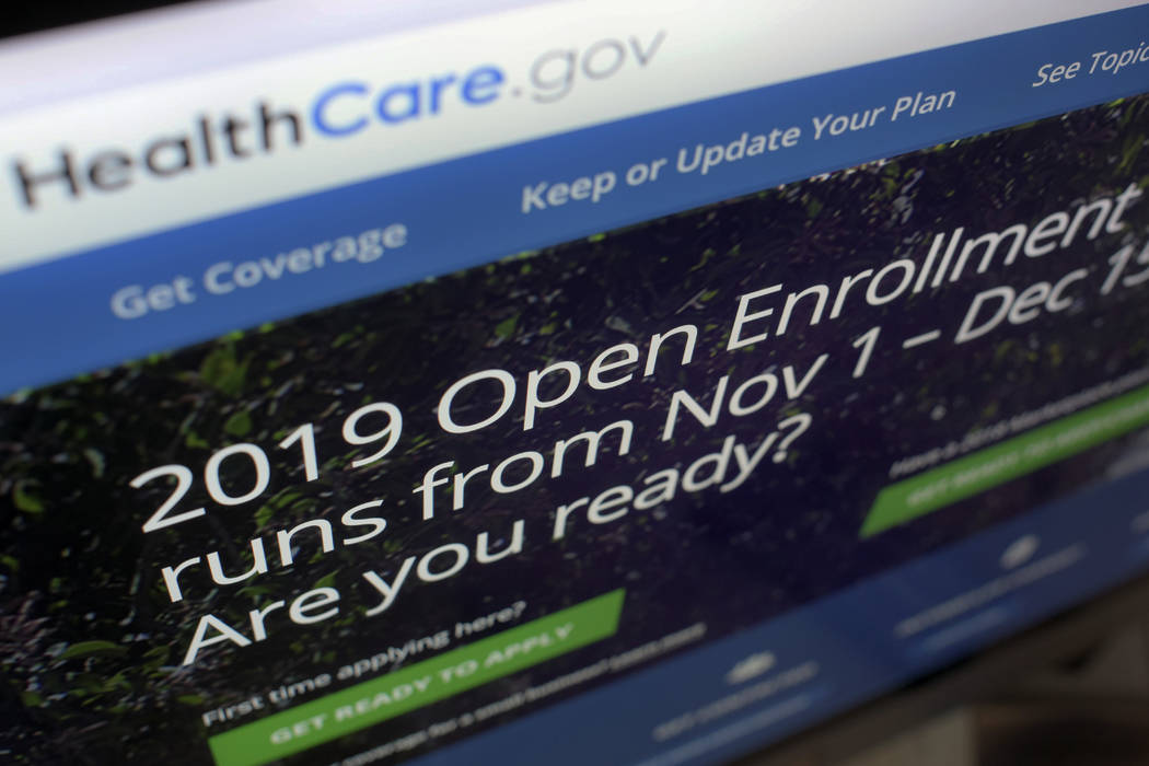 FILE - This Oct. 23, 2018 file photo shows HealthCare.gov website on a computer screen in New York. A federal judge's ruling that the Obama health law is unconstitutional has landed like a stink ...
