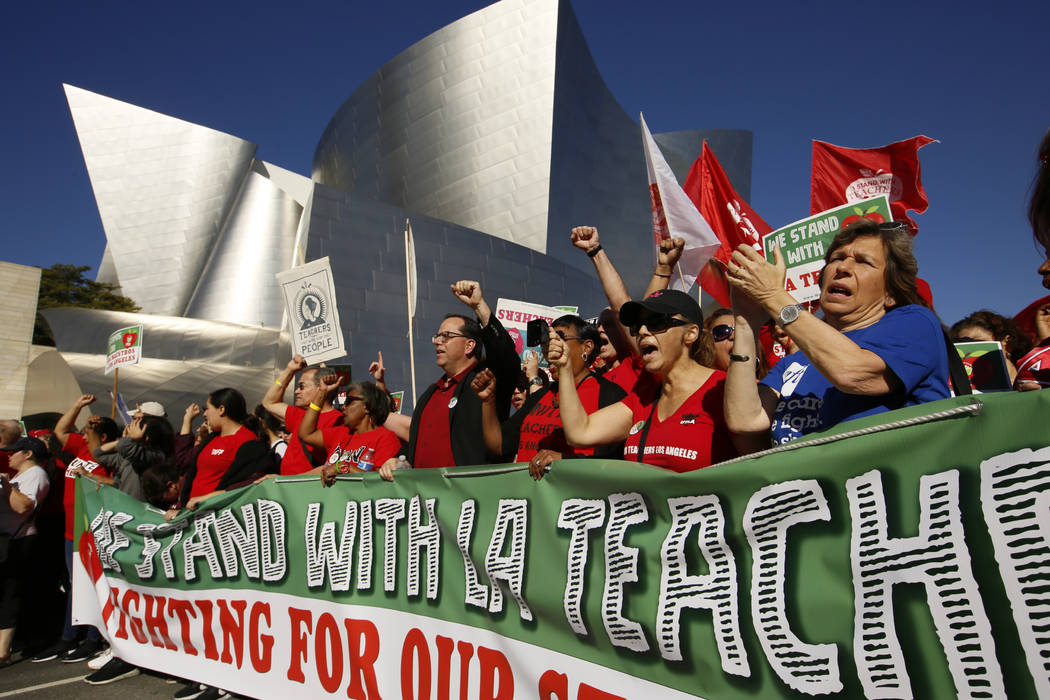United Teachers Los Angeles leaders are joined by thousands of teachers, who may go on strike against the nation's second-largest school district next month, as they march past the Walt Disney Con ...