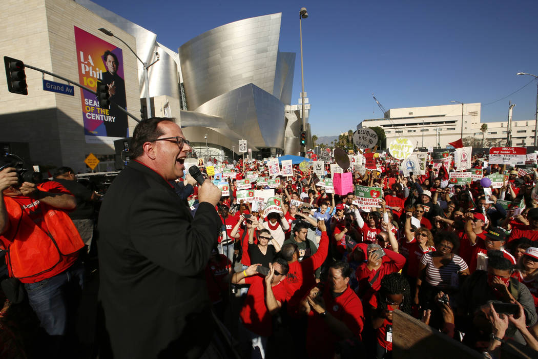 United Teachers Los Angeles president Alex Caputo-Pearl addresses thousands of teachers, who may go on strike against the nation's second-largest school district next month, as they rally next to ...