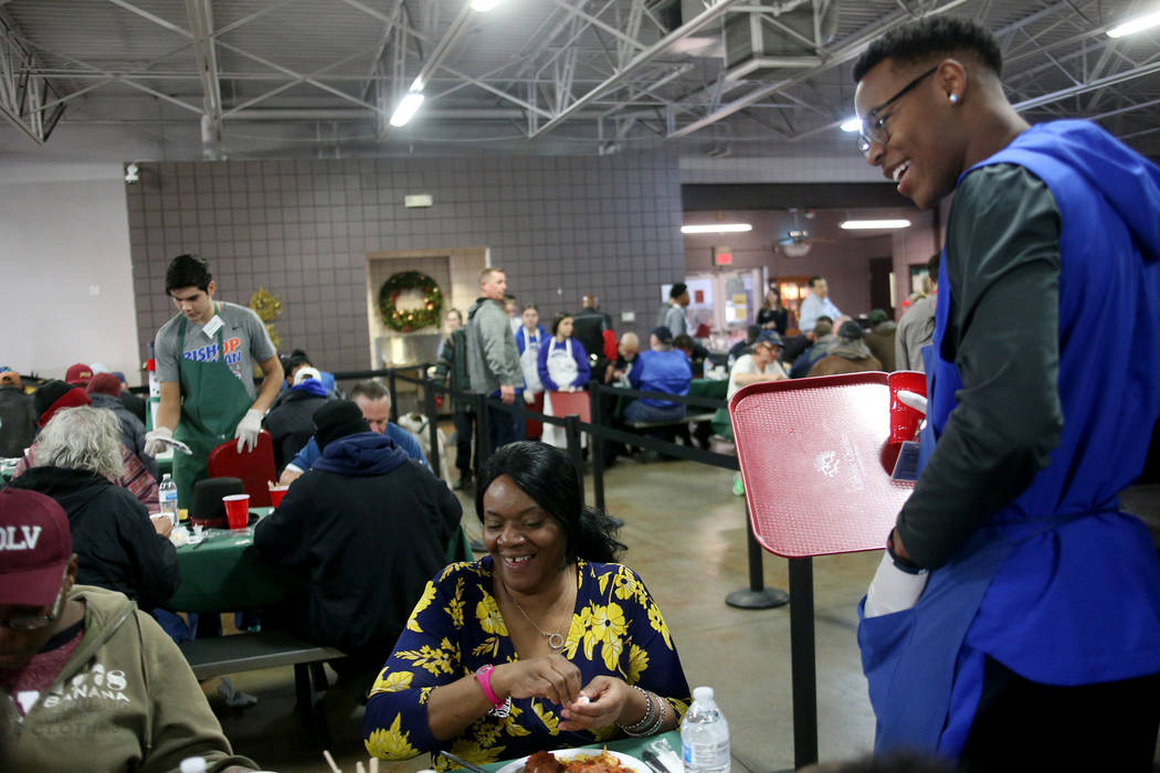 Donovan Smith, 17, laughs with Laurice Adams at the Christmas meal sponsored by the Frank and Victoria Fertitta Foundation, at Catholic Charities of Southern Nevada in Las Vegas, Sunday, Dec. 16, ...