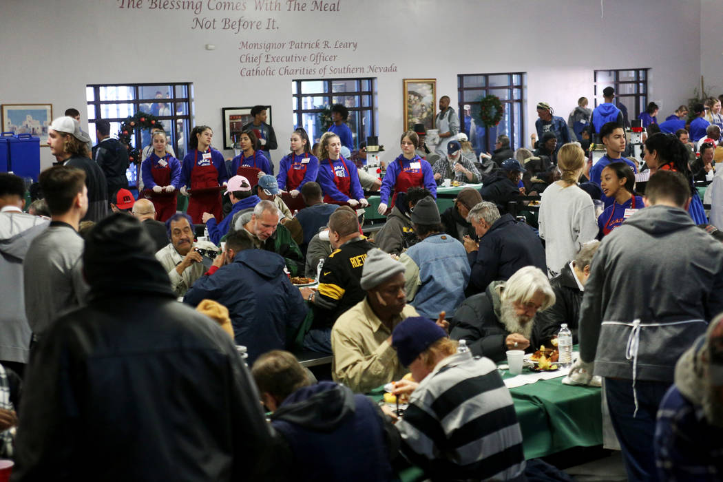 The Christmas meal sponsored by the Frank and Victoria Fertitta Foundation, at Catholic Charities of Southern Nevada in Las Vegas, Sunday, Dec. 16, 2018. Students from the Bishop Gorman High Schoo ...