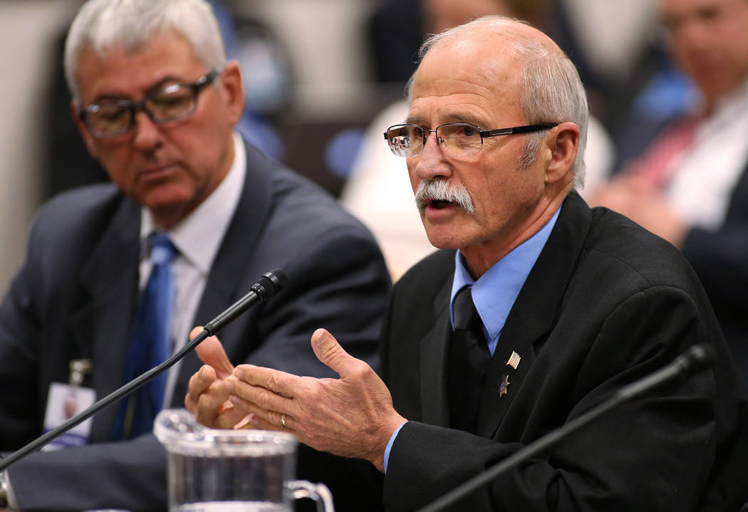 Lobbyists Rusty McAllister, left, and Ron Dreher talk about transparency in the collective bargaining process during a committee hearing at the Legislative Building in Carson City, Nev., on Friday ...