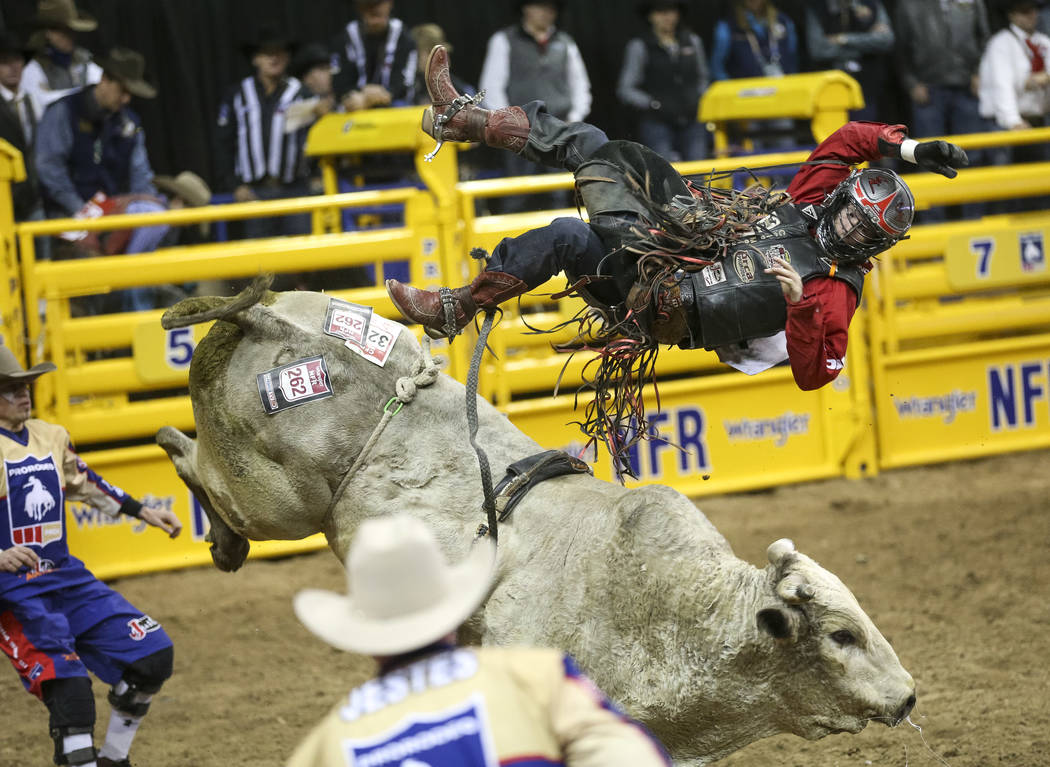 Cole Melancon of Liberty, Texas (98) gets bucked off Blackstone After Party while competing in the bull riding event during the ninth go-round of the National Finals Rodeo at the Thomas & Mack ...