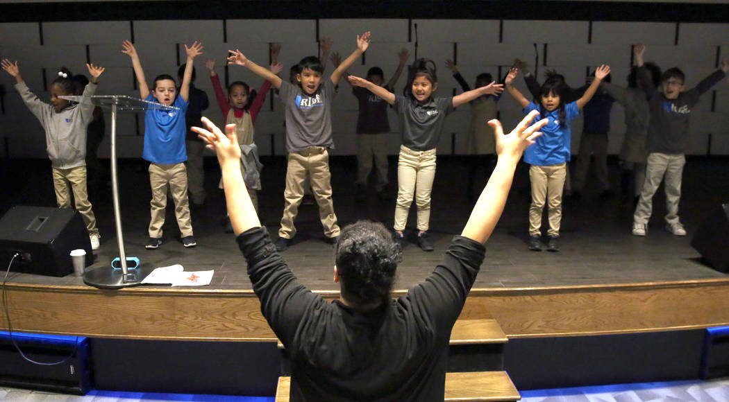 """Lesleigh Valette, visual and performing arts teacher, guides kindergartners as they rehearse for their holiday show """"Around The World"""" at Nevada Rise Academy on Tuesday, Dec. 11, 2018, i ..."""