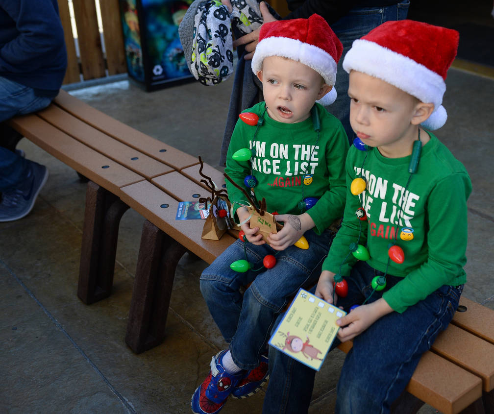 Ryder Clark, 4, left, and Colin Clark, 5, from Las Vegas listen as a story is read out loud during the Holiday Express taking place at Springs Preserve in Las Vegas, Sunday, Dec. 16, 2018. Carolin ...