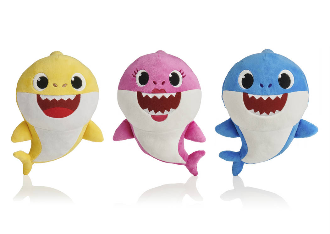 This picture shows the WowWee pinkfong Baby Shark family of singing plush toys. (AP Photo/WowWee)