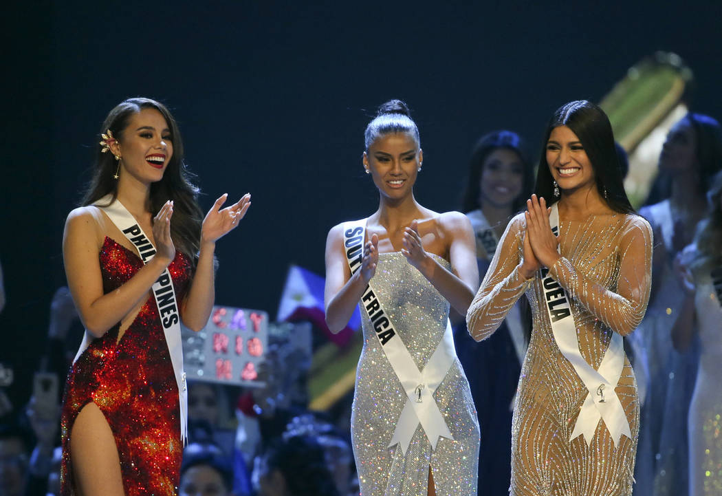 Miss Philippines Catriona Gray, left, Miss South Africa Tamaryn Green, center, applaud as Miss Venezuela Sthefany Gutierrez, right was announced as the second-runner up of the 67th Miss Universe c ...