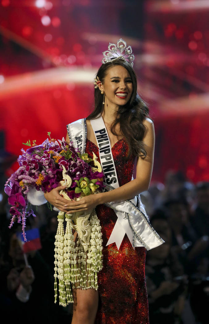 Miss Philippines Catriona Gray walks after being crowned Miss Universe during the final round of 67th Miss Universe competition in Bangkok, Thailand, Monday, Dec. 17, 2018. (AP Photo/Gemunu Amaras ...