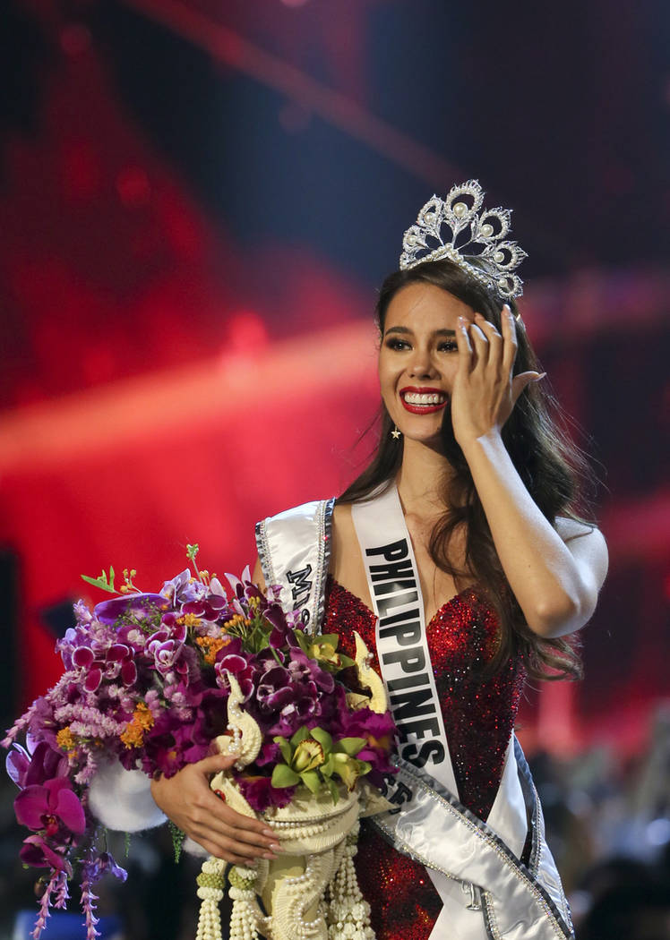 Miss Philippines Catriona Gray walks after being crowned as the winner of 67th Miss Universe competition in Bangkok, Thailand, Monday, Dec. 17, 2018. (AP Photo/Gemunu Amarasinghe)