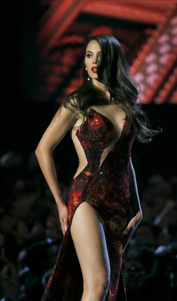 Miss Philippines Catriona Gray presents evening gown during the final of 67th Miss Universe competition in Bangkok, Thailand, Monday, Dec. 17, 2018. (AP Photo/Gemunu Amarasinghe)