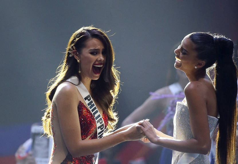 Miss Philippines Catriona Gray, left, Miss South Africa Tamaryn Green, right react as Gray was announced as the winner of Miss Universe during the final round of the 67th Miss Universe competition ...