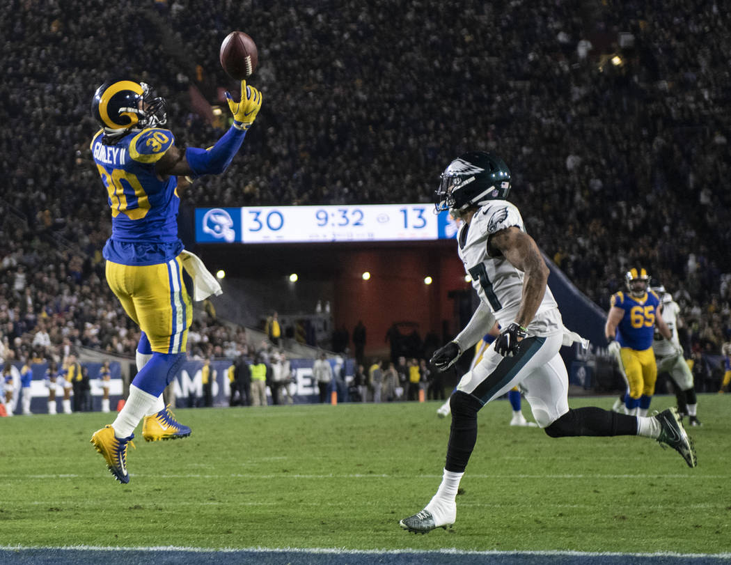 Los Angeles Rams running back Todd Gurley, left, can't catch a pass as Philadelphia Eagles defensive back Tre Sullivan looks on during the second half of an NFL football game Sunday, Dec. 16, 2018 ...