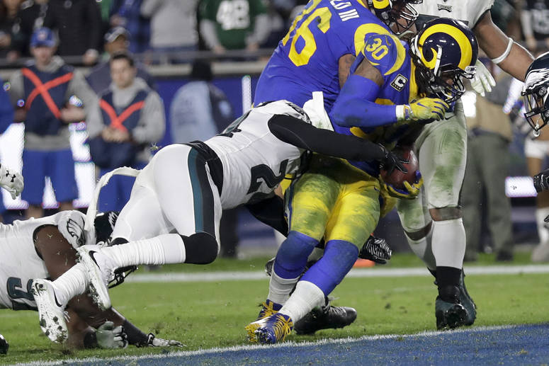 Los Angeles Rams running back Todd Gurley, right, scores past Philadelphia Eagles free safety Corey Graham during the second half in an NFL football game Sunday, Dec. 16, 2018, in Los Angeles. (AP ...